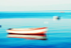 Boats on lake and the horizon, motion blur Royalty Free Stock Photography