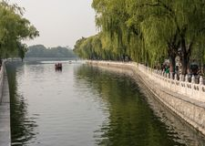 Boats on the lake at Hutong in Beijing. BEIJING, CHINA - 20 OCTOBER 2018: Tourists in boats on Lake Houhai in the Hutong neighborhood stock photo