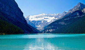 Boats in lake Louise under glacier. Stock Image