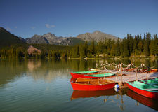 Boats Lake Mountains Adventure. Boats in the harbor and beautiful large lake in the mountains stock photos