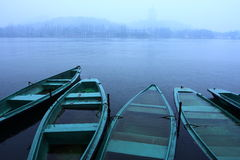 Boats in the lake raining. Boats in the lake its raining Stock Photos