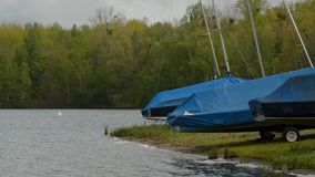 Boats on shore at lake stock video footage