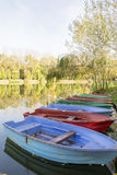 Boats on lake shore in autumn Stock Photo