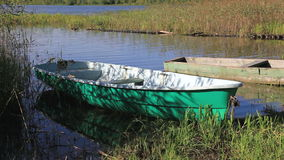 Boats on the lake in summertime stock footage