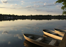 Boats in in the lake at sunrise Stock Photography