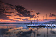 Boats. On a lake during sunset Stock Image