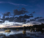 Boats in the lake at sunset in Yamba, Australia Stock Photos