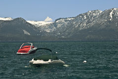 Boats at Lake Tahoe. With mountains royalty free stock image