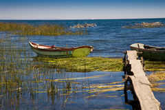 Boats on Lake Titicaca. Boats close to pier on Lake Titicaca in Bolivia Stock Photos