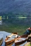 Boats on Lake Ullswater. Close up of wooden rowing boats on Lake Ullswater, Lake District National Park, Cumbria, England royalty free stock photography