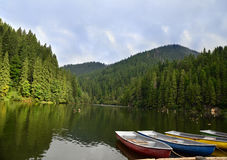 Boats on the lake. View of boats floating on mountain lake Stock Images