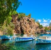 , Boats on Lake Voulismeni. Agios Nikolaos, Crete Stock Photo