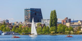 Boats on Lake Zug. Zug, Switzerland - 6 May, 2016: boats on Lake Zug, buildings of the city of Zug in the background. The city of Zug is the capital of the Swiss Royalty Free Stock Photo