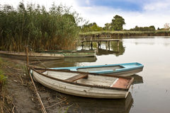 Boats at the lakeside Stock Photos