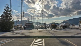 Boats in late summer in marina. A nicely parked boats and yachts in Tivat marina in Montenegro Royalty Free Stock Photo