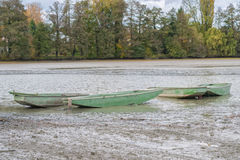 Boats in a launched pond Royalty Free Stock Photos