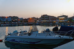 Boats in Lefkada Harbour, Greece. Modern recreational boats moored in the harbour at Lefkada, an Ionian Greek island, Greece, at dusk, with waterfront tavernas royalty free stock photography