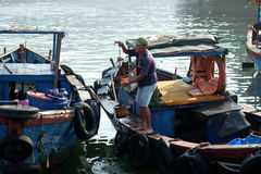 Boats and Lifestyle at Qui Nhon Fish Port, Vietnam in the morning. Royalty Free Stock Photo