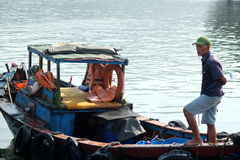 Boats and Lifestyle at Qui Nhon Fish Port, Vietnam in the morning. Royalty Free Stock Photography