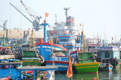 Boats and Lifestyle at Qui Nhon Fish Port, Vietnam in the morning. Stock Photos