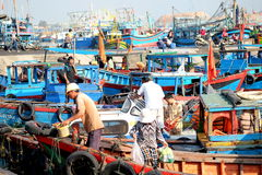 Boats and Lifestyle at Qui Nhon Fish Port, Vietnam in the morning. Stock Photography