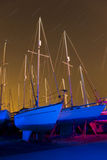 Boats light painted with star trails Stock Image