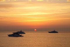 Boats in the Ligurian sea at sunrise Stock Photos