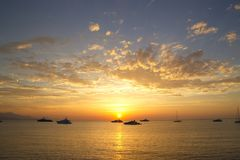 Boats in the Ligurian sea at sunrise Royalty Free Stock Photo