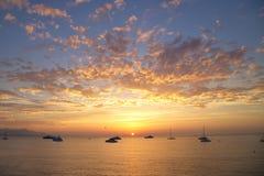 Boats in the Ligurian sea at sunrise Stock Photo