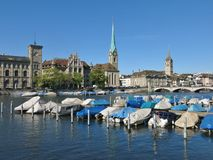 Boats on the Limmat and Fraumuenster Stock Photos