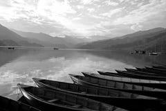 Boats lined up on pokhara lake Stock Image