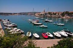Boats on little port beside Krk old town -Croatia Stock Photo