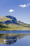 Boats on Loch leathann with the old man of storr. Old Man of Storr on the Isle of Skye in Scotland stock image