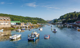 Boats on Looe river Cornwall England blue sea and sky Royalty Free Stock Image