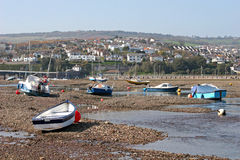 Boats at low tide Stock Images