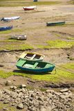 Boats in low tide Stock Photos