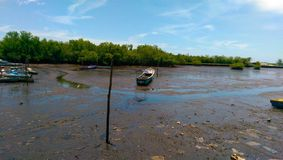 Boats in low tide Stock Photography