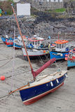 Boats at low tide in Coverack harbour UK Royalty Free Stock Photos