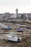 Boats  at low tide in a harbour Stock Photos