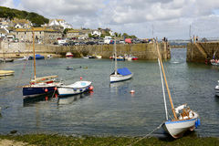 Boats with low tide at Musehole harbour, Cornwall Stock Images