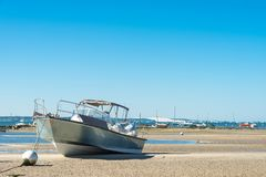 Arcachon Bay, France, in front of the dune of Pyla. Boats at low tide near the Cap Ferret on the Arcachon Bay, in front of the dune of Pyla, the highest sand Stock Images