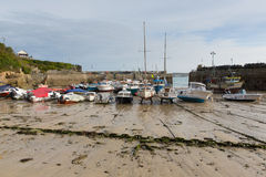 Boats low tide Newquay harbour Cornwall England UK Stock Images