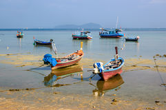 Boats at low tide, Phuket, Thailand Royalty Free Stock Photos