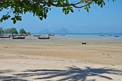 Boats at low tide. Low tide and boats on shore in ko mook island, thailand Royalty Free Stock Photos
