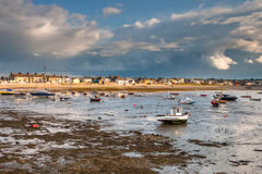 Boats at low tide in Skerries Harbour, Ireland. Landscape of irish coastline at sunset in Skerries, Dublin Stock Photography