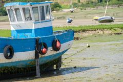 Boats at low tide. Boats without water at low tide royalty free stock photos