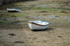 Boats at low tide. Boats without water at low tide stock image