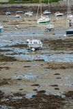 Boats at low tide. Boats without water at low tide stock photo