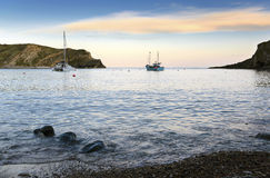 Boats at Lulworth. Late evening at Lulworth Cove on Dorset's Jurassic Coast Stock Images