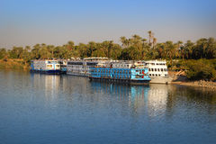 Boats in Luxor, Egypt. Luxor, EGYPT - FEBRUARY 2, 2016: Boats docked and along the shore waiting for the next Nile River cruise at Luxor, Egypt Stock Photo